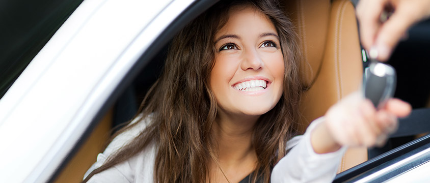 Smiling lady in car