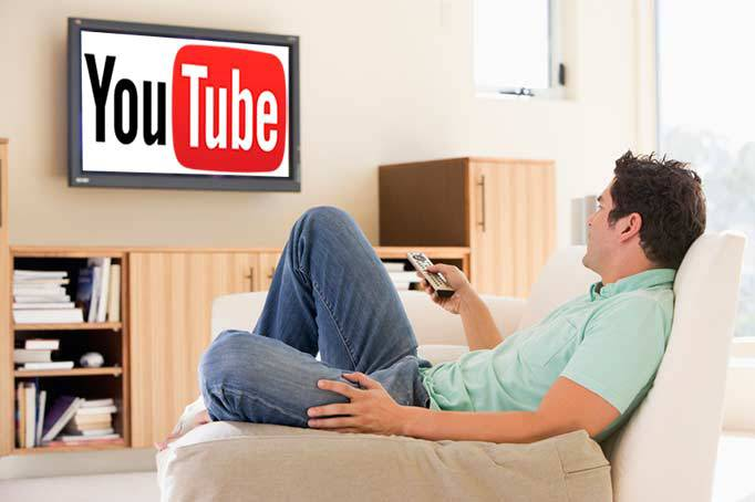 man-on-sofa-watching-youtubejpg