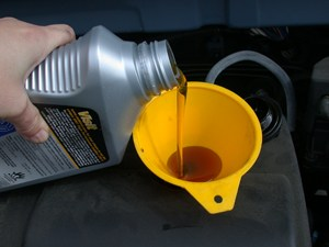 motor_oil_refill_with_funneljpg